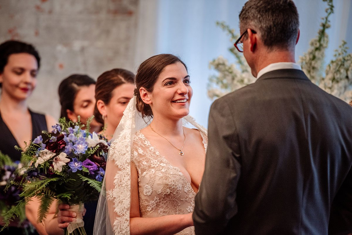 bride looks at groom during wedding ceremony at aria in minneapolis