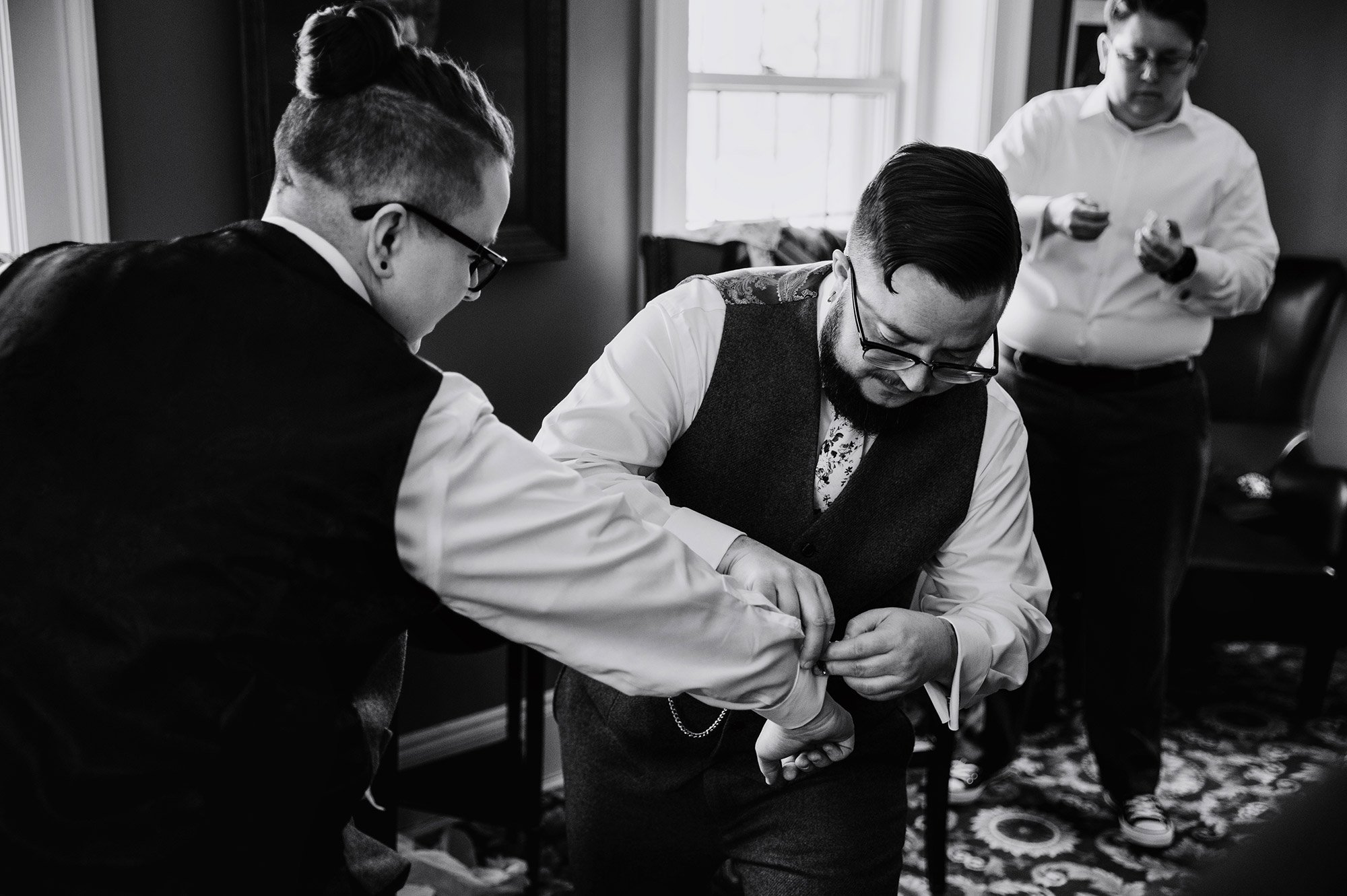 bride and attendant get in their suits st paul college club wedding mn lgbtq photographer