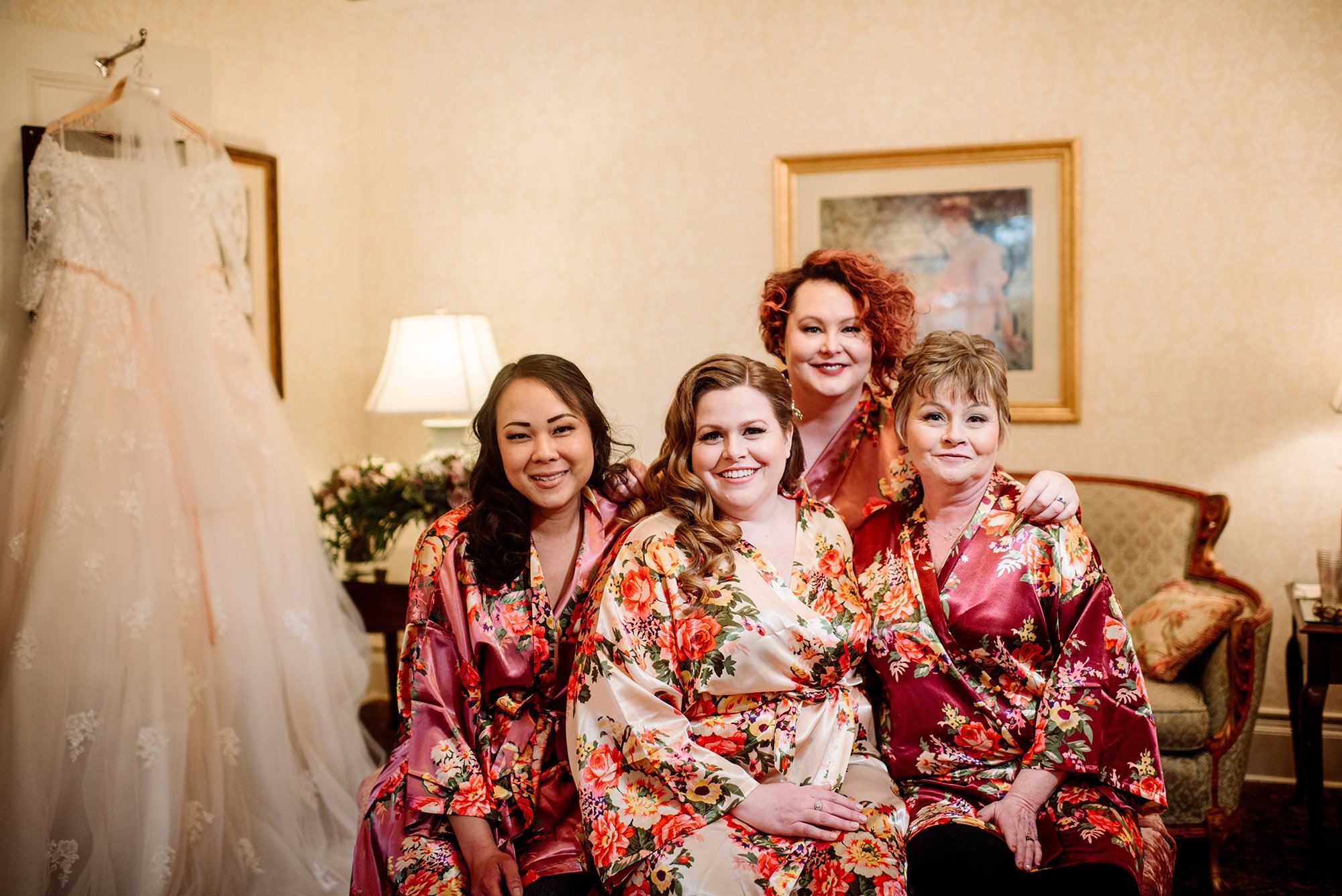 bride with attendants in floral robes st paul college club wedding mn