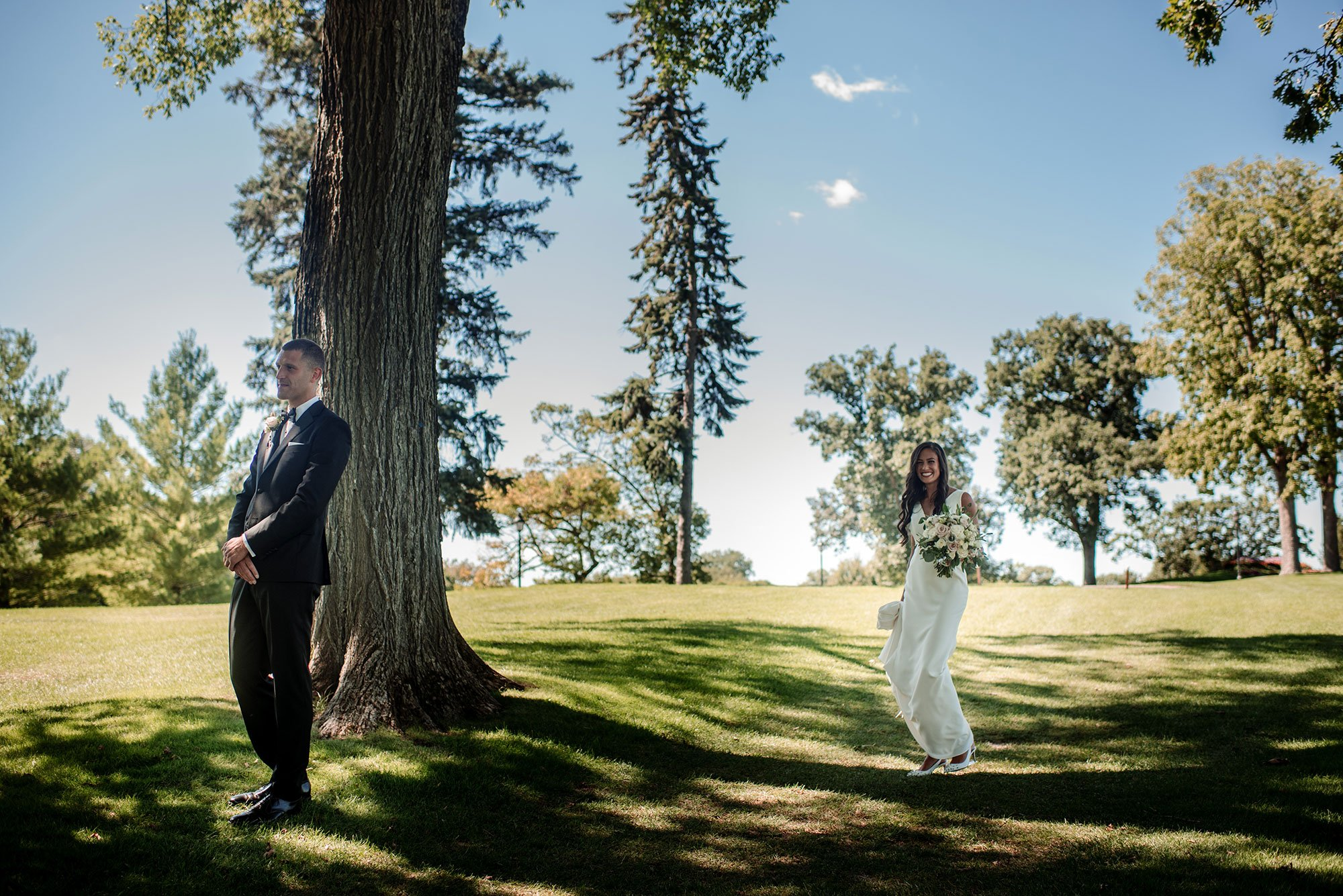 bride and groom first look interlachen country club mn