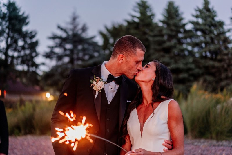 sparklers with bride and groom at end of night hyland hills wedding mn