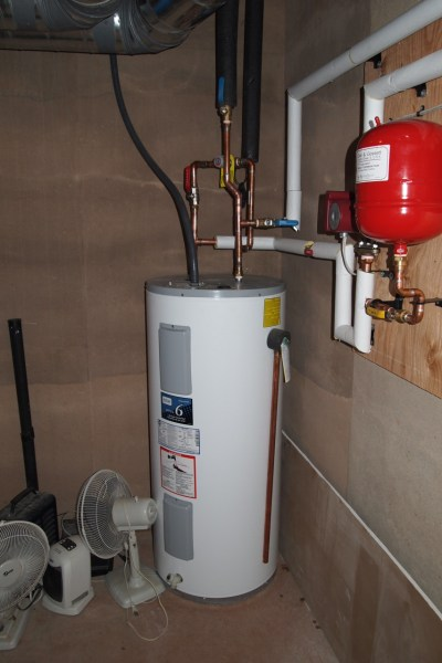 Hot water tank for domestic hot water and heat pump