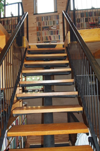 Repurporsed staircase in rammed earth house
