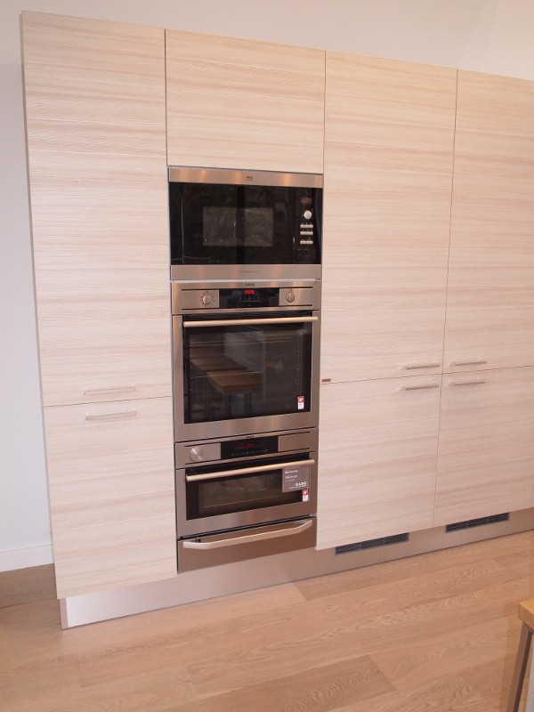 AEG appliance tower featuring microwave, oven and steam oven