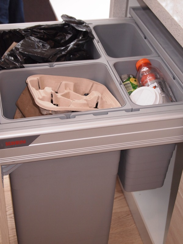 Recycling bins built in to cabinetry by Scavolini