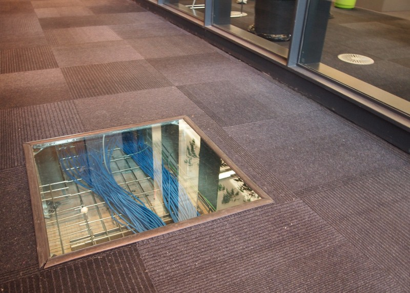 Flooring with clear removable tiles for easy access to wiring