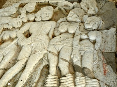A relief sculpture of Ashoka the Great (left) found at Gulbarga stupa in southern India and dating from 1-200 CE.