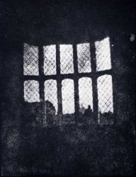 william Henry Fox Talbot's photograph of a latticed window at Lacock Abbey, from 1835. This print may be from the oldest negative in existence.