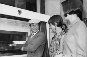 Comedic actor Reg Varney performs the first transaction on Barclay Bank's ATM in 1967.