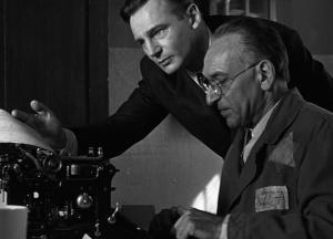 Liam Neeson (as Oskar Schindler) and Ben Kingsley in Schindler's List (2001).