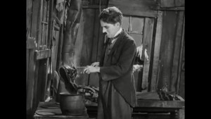 Charlie Chaplin boils his boot in The Gold Rush.