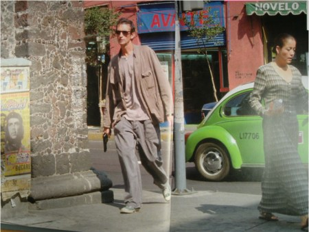 Francis Alÿs carrying a pistol in Mexico City in his performance piece, 'Reenactments' (2001).