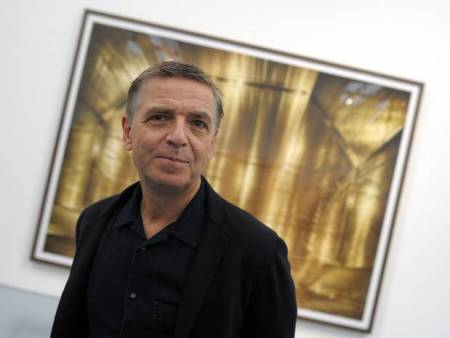 Andreas Gursky stands in front of his photograph. Getty Photo.
