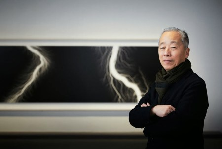 Hiroshi Sugimoto with a photograph from his Lightning Fields series.