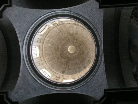 Juan Baptista de Toledo conceived the original plans for the El Escorial complex, including a monastery and a royal palace, but did not live to see the project completed. His design for the dome of the Basilica, shown here from inside the church, was based on that of St. Peter's.