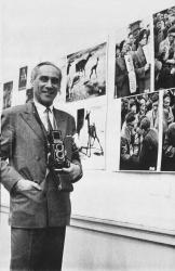 A 1957 photograph of Helmuth Pirath with his photographs in Amsterdam, by Ben van Meerendonk/ISSG.