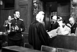 A photograph of Yevgeny Khaldei (far left) at the Nuremberg trial of Hermann Goehring in 1945 or 1946.