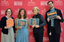 Keynote speaker Kathryn Funk poses with members of Becker Library's publishing and analytics team.