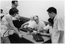 Alan Perlis (seated) and Herbert Simon (standing left) meeting with Chinese computer scientists, 1972
