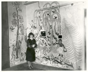 Artist Gisella Loeffler poses with her work