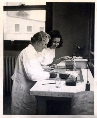 Margaret G. Smith, MD, working with a student assistant, circa 1940
