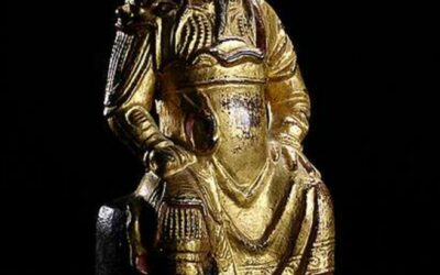 MING DYNASTY, GILT, RED AND BLACK LACQUERED BRONZE FIGURE OF GUANDI