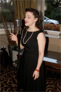 Becki Short performing at a vintage themed wedding