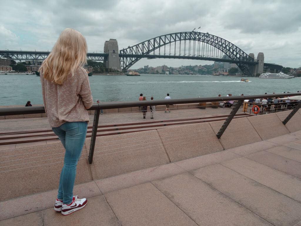 Standing in front of the harbour bridge in Sydney
