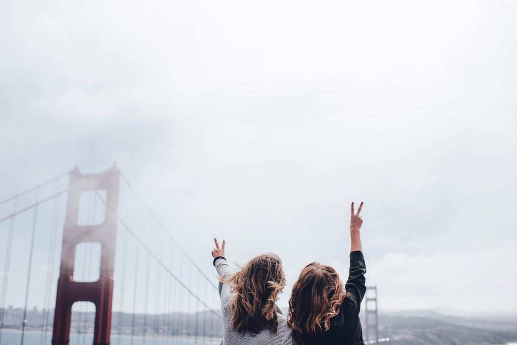 Two people in front of the Golden Gate Bridge in San Francisco