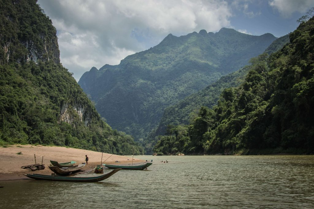 Two boats by the water in Laos