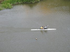 Canoeists paddling against the tide