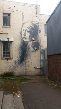 Girl with the Pierced Eardrum by Banksy, Bristol.