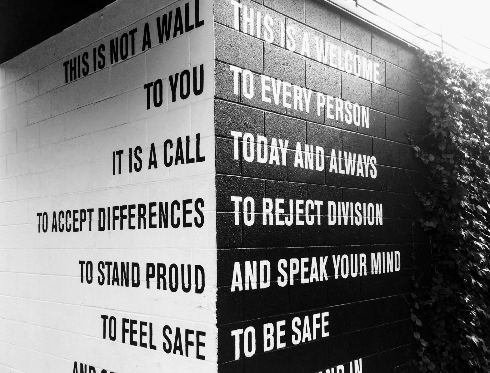 Wall showing two messages of inclusion and acceptance