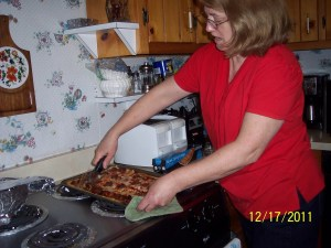 Preparing Trays of bacon in advance for multiple breakfast plated as time management practice.