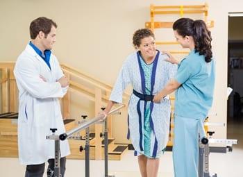 patient being steadied by using gait belt