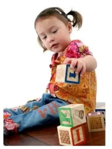 Child with developmental disability playing with blocks
