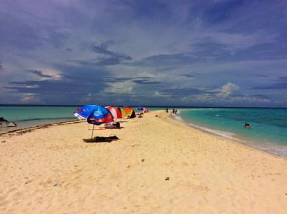 sandbar w/ rentable umbrellas for P150