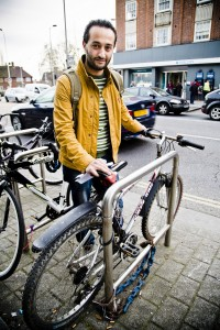 Ne Ver locks his bike, The Heathway. Photo by AF Rodrigues