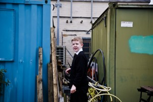 Seth between containers, Birch Sap Collection at Eastbrookend Park. Photo by Antony and Harry