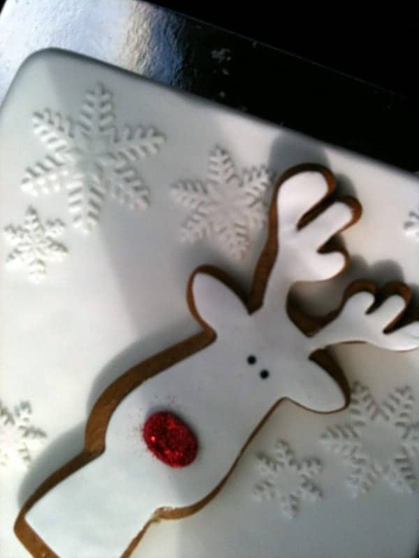 Christmas cake with Rudolf Gingerbread cookie on top