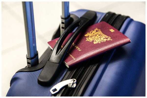 Flight Delays - photo of suitcase and British passport