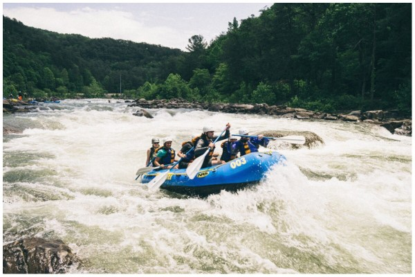 Image of people white water rafting down a river in Colorado