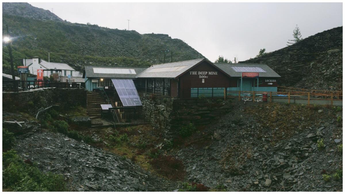 Moody grey photo of The Deep Mine entrance at Llechwedd Slate Caverns, Blaenau Ffestiniog