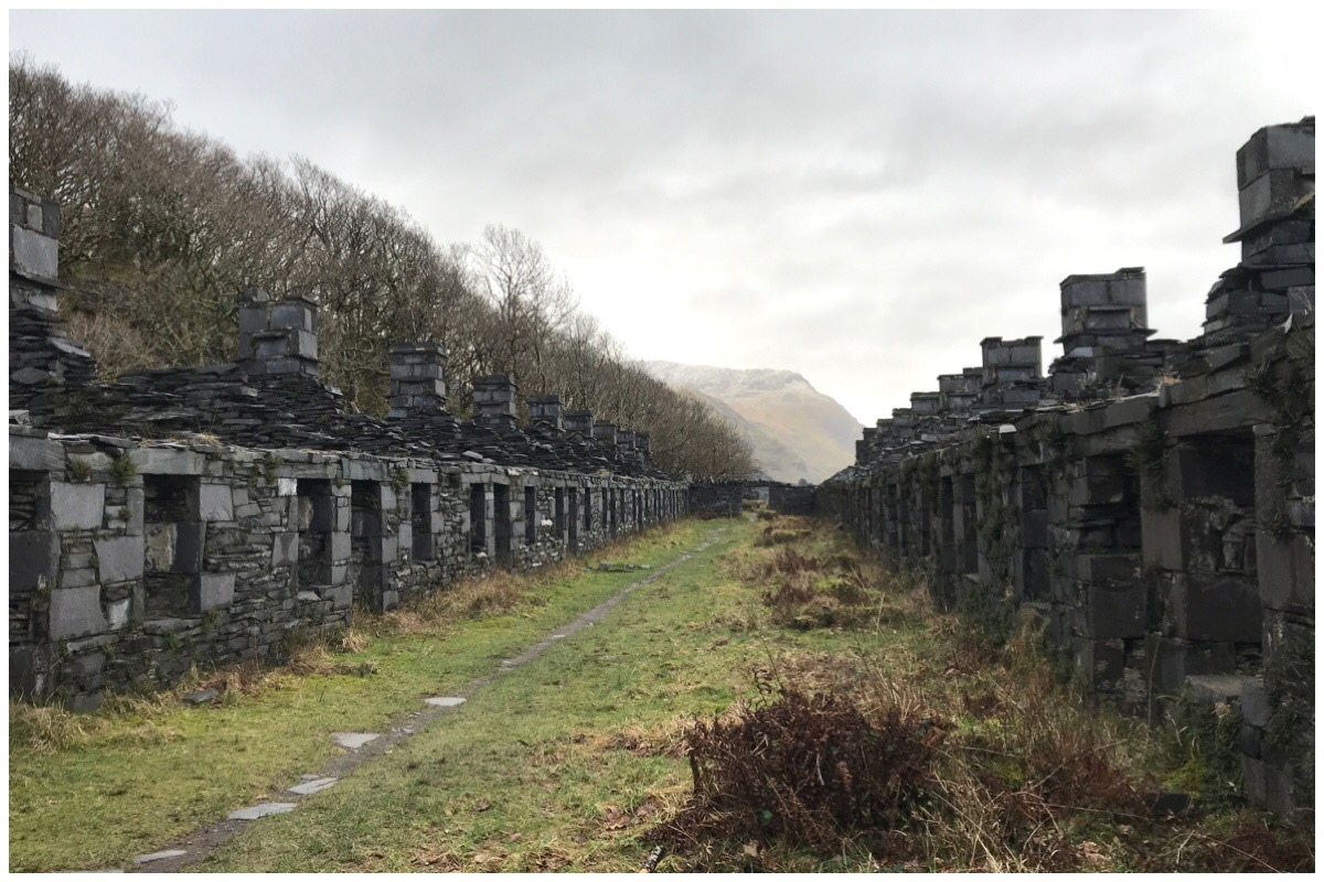 The ruins of Anglesey Barracks at Dinorwig Quarry. Two rows of quarrymen houses made of slate.