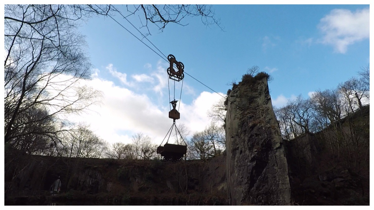 An old blondin suspended over Vivian Quarry