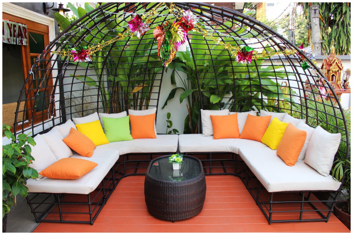 Patio furniture with white, yellow and orange cushion