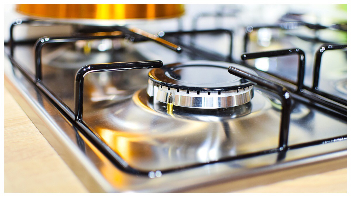 Photo of a gas ring on a stainless steel cooker