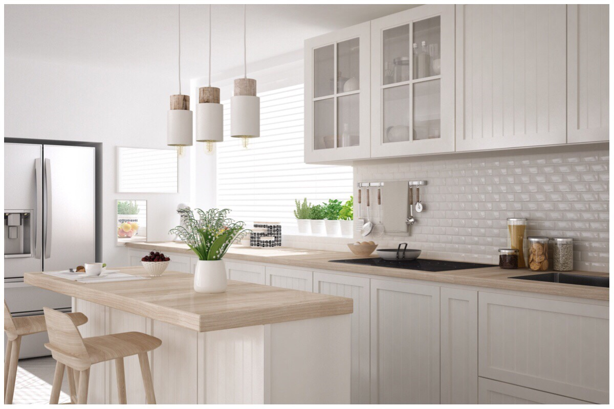 Cream coloured stylish kitchen with light brown worktops - my dream kitchen!