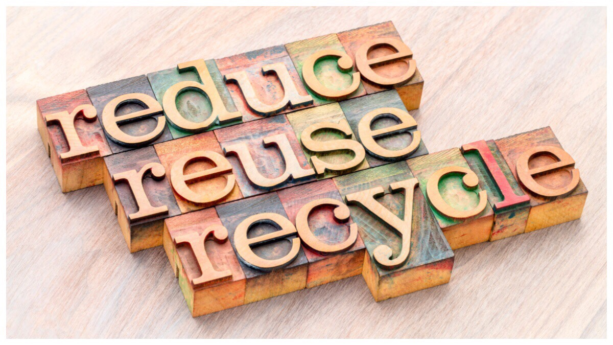 The words reduce reuse and recycle made from blockwood