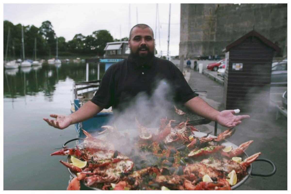 "Chris ""Foodgasm"" Roberts with his epic seafood paella on Cei Llechi, Caernarfon"